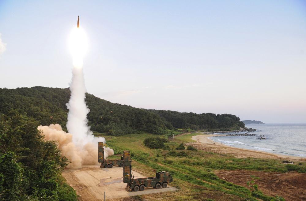 "South Korea Defense Ministry via AP South Korea's Hyunmoo II ballistic missile is fired during an exercise Monday. The nation's military said it conducted a live-fire exercise simulating an attack on North Korea's nuclear test site to ""strongly warn"" Pyongyang over the latest nuclear test. Seoul's Joint Chiefs of Staff said the drill involved F-15 fighter jets and the country's land-based Hyunmoo ballistic missiles. The live weapons ""accurately struck"" a target in the sea off the country's eastern coast, the JCS said."