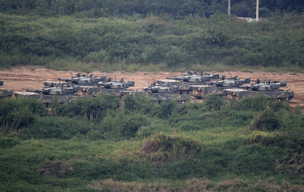 "South Korean K-1 tanks are seen in Paju, South Korea, on Sunday. North Korea announced it detonated a thermonuclear device Sunday in its sixth and most powerful nuclear test to date, a big step toward its goal of developing nuclear weapons capable of striking anywhere in the U.S. The North called it a ""perfect success"" while its neighbors condemned the blast immediately."