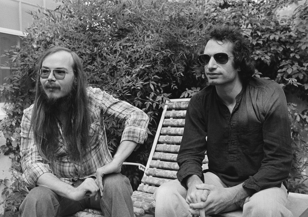 Walter Becker, left, and Donald Fagen of Steely Dan, sit in Los Angeles. Becker, the guitarist, bassist and co-founder of the rock group Steely Dan, has died. He was 67.
