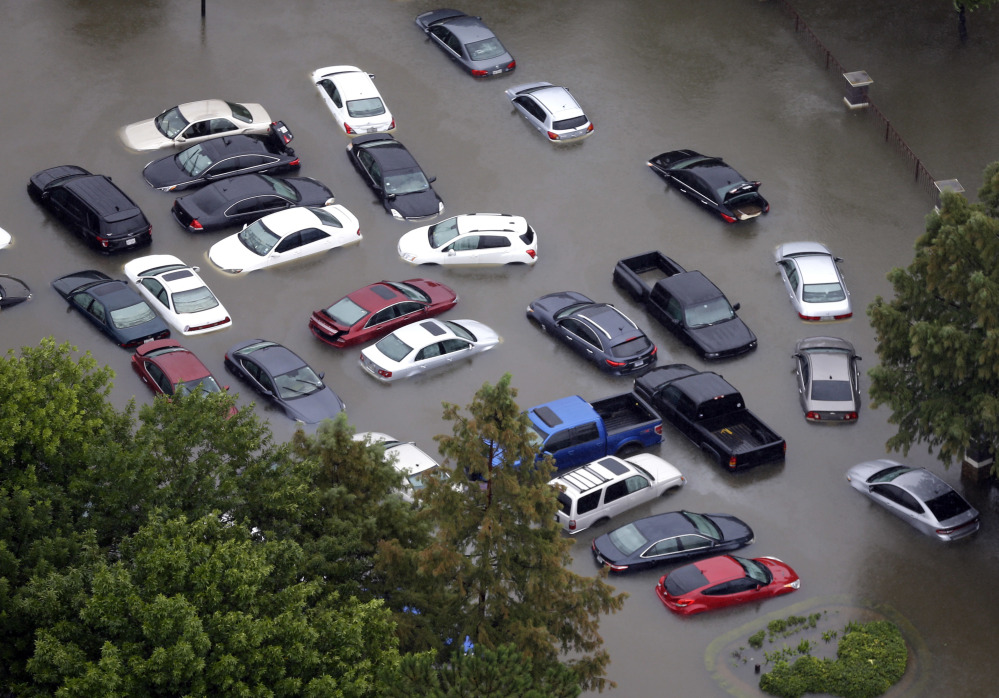 Dozens of flooded vehicles near Houston's Addicks Reservoir may likely never be fit to drive again. Hundreds of thousands of cars, vans and trucks have been flooded in driveways, parking lots and dealerships, creating a demand that could raise prices.