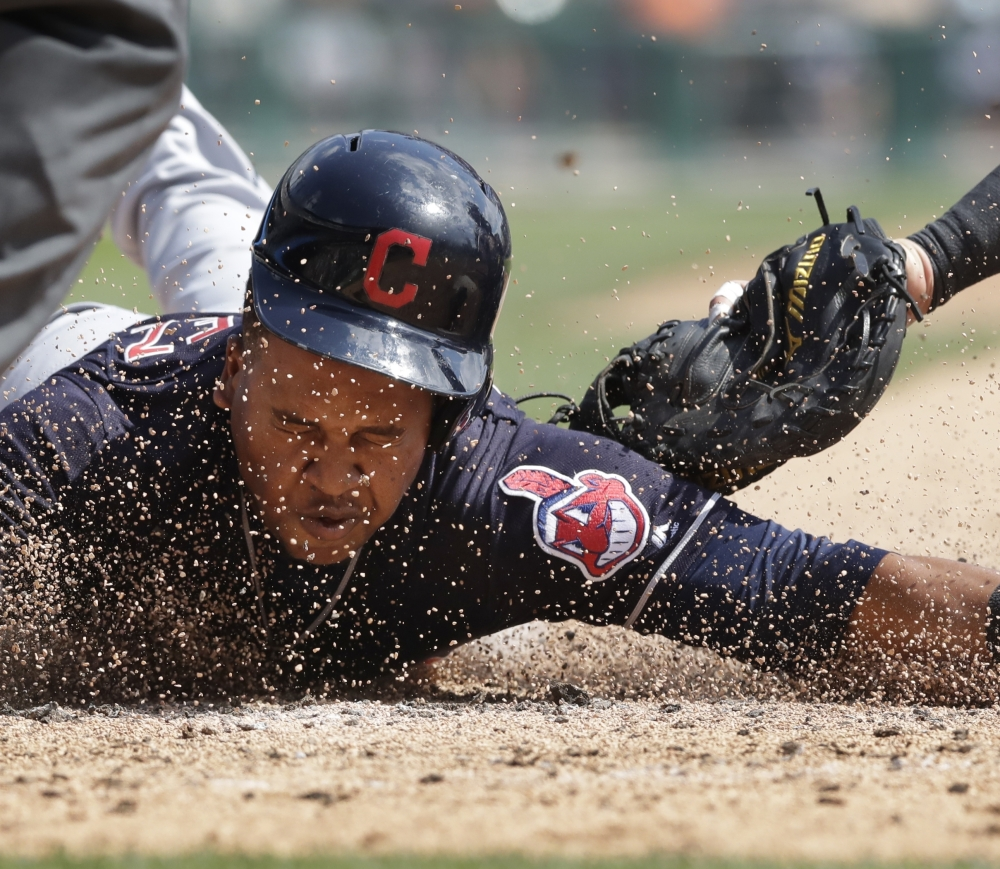 Cleveland's Jose Ramirez beats the tag of Detroit catcher James McCann in the third inning Sunday. Ramirez had five extra base hits and the Indians won 11-1.