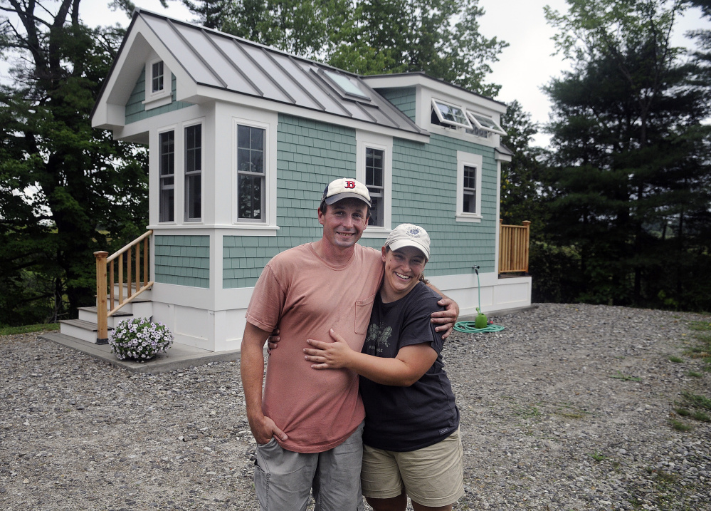Luke Lucier and Becky Deering stand outside their tiny home in Richmond, where the code enforcement officer has said no more of these homes will be allowed until there are state inspection standards in place.