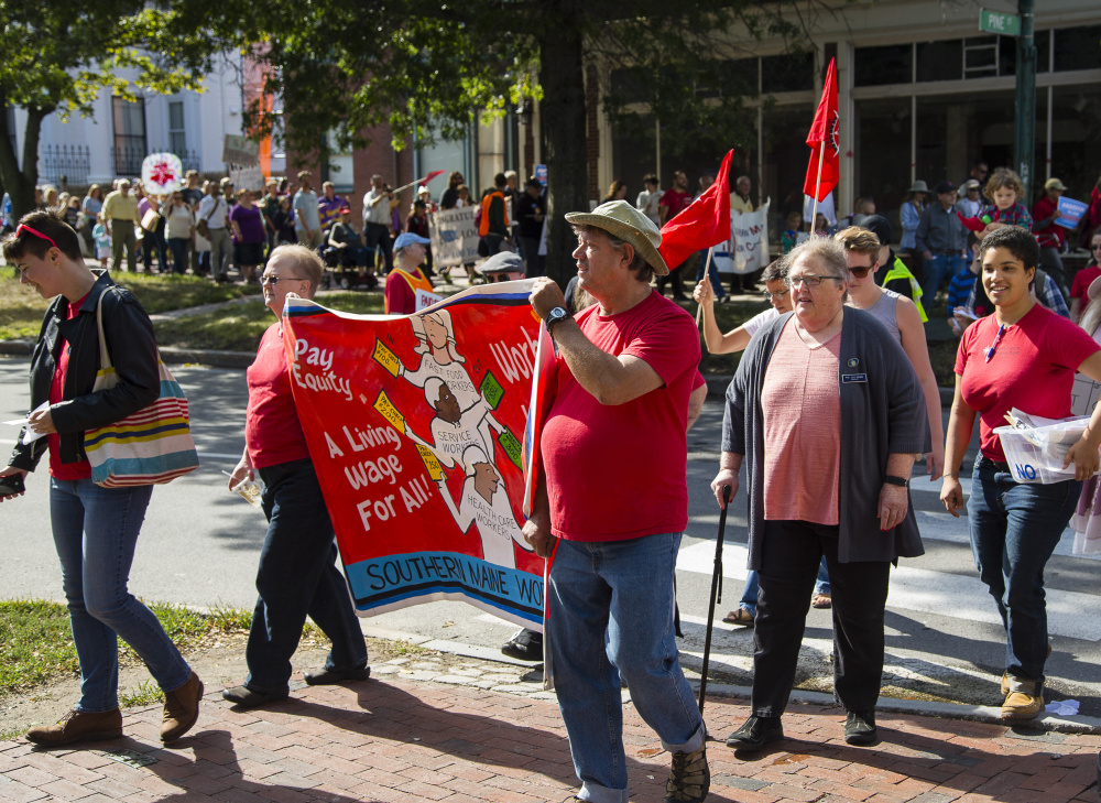 Marchers head up State Street to a rally in Portland's Longfellow Square on Monday, to launch a campaign for earned sick days for Portland workers under a proposed city ordinance.