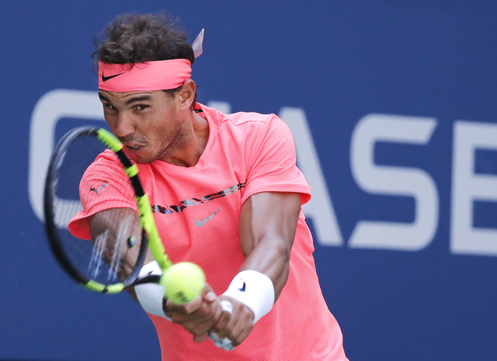 Rafael Nadal returns a shot against Alexandr Dolgopolov during their fourth-round match Monday at the U.S. Open. Nadal, the No. 1 seed, cruised to a 6-2, 6-4, 6-1 victory.