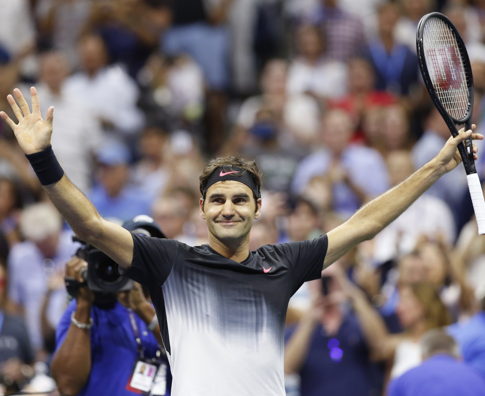 Roger Federer celebrates after his 6-4, 6-2, 7-5 win Monday night against Philipp Kohlschreiber, which kept him on track for a possible semifinal showdown against Rafael Nadal.
