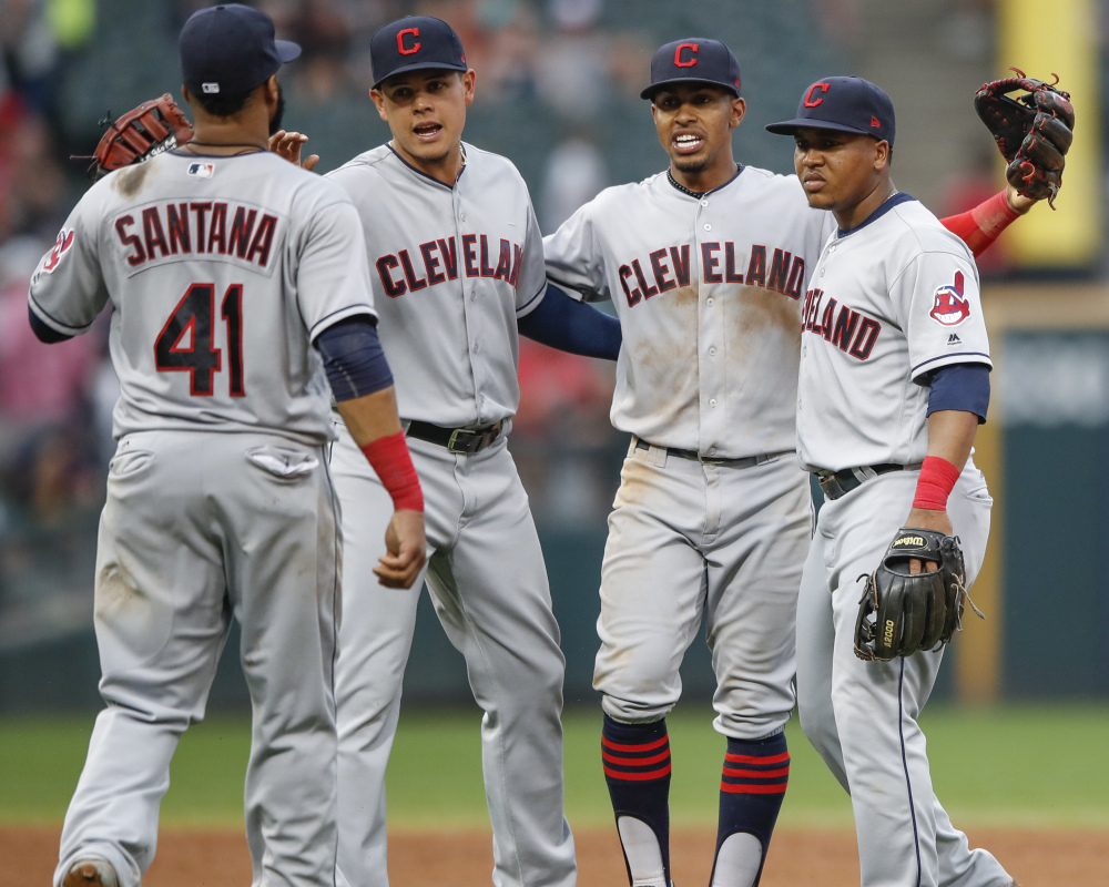 Indians players celebrate Monday after their 12th consecutive victory – 5-3 against the Chicago White Sox.