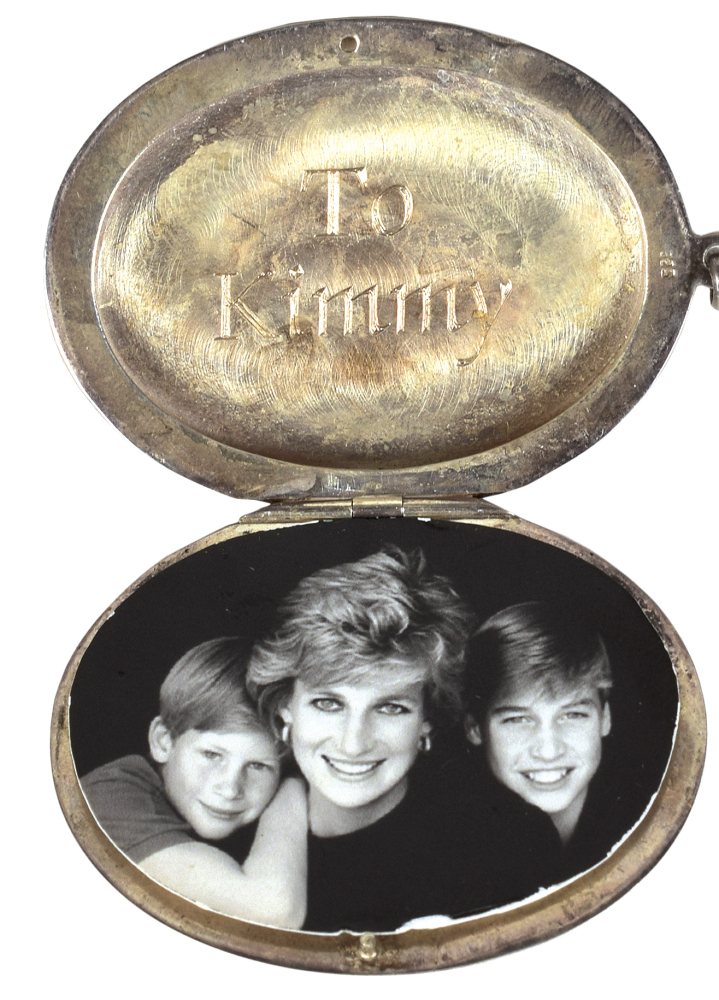 A locket – holding a photo of Princess Diana and her sons, Prince Harry, left, and Prince William – is for sale.