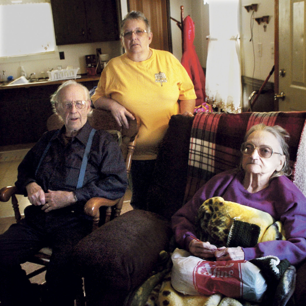 Richard and Leonette Sukeforth, shown seated on Jan. 5, now live in Holden with their daughter Yvette Ingalls, after being evicted from their home in Albion for failing to pay property taxes.