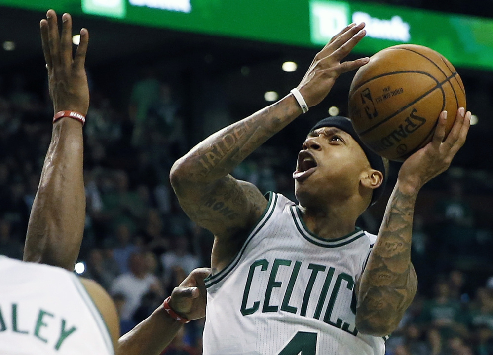 Boston Celtics' Isaiah Thomas shoots during the fourth quarter of a first-round NBA playoff basketball game against the Chicago Bulls, Sunday, April 16, 2017, in Boston. The Bulls won 106-102. (AP Photo/Michael Dwyer)