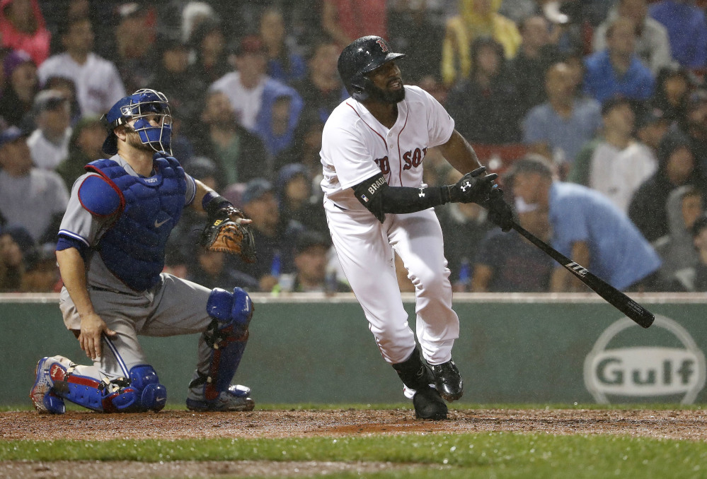 Boston's Jackie Bradley Jr. watches his two-run home run, next to Toronto Blue Jays catcher Miguel Montero, in the fourth inning of Wednesday' game at Fenway Park.