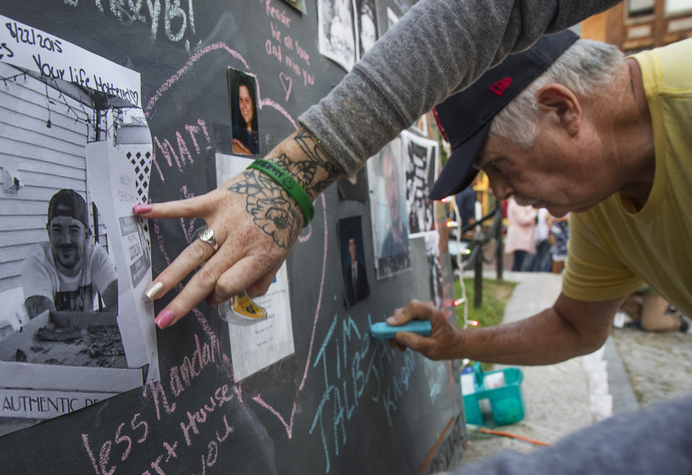 On Aug. 31 – International Overdose Awareness Day – Timothy Talbot Sr. of Portland writes on a Memorial Wall in Monument Square in honor of his son, Timothy Talbot Jr., one of the 185 Mainers who died of drug overdoses in the first six months of this year.
