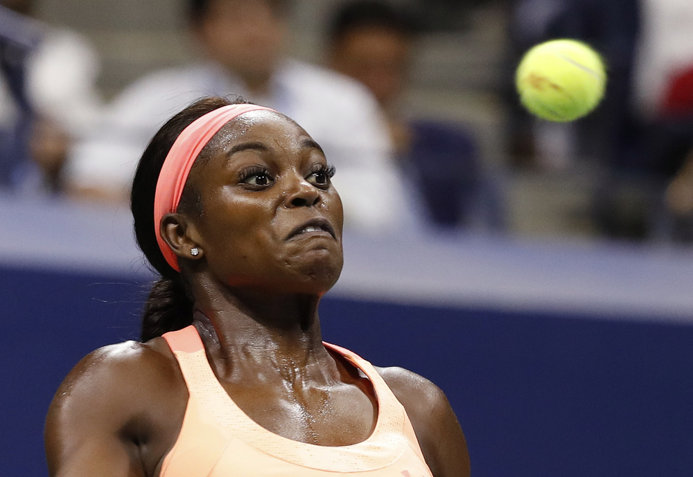 Sloane Stephens returns a shot from Venus Williams during the semifinals of the U.S. Open on Thursday in New York. Stephens rallied in the third set to win the match and advance to the final.