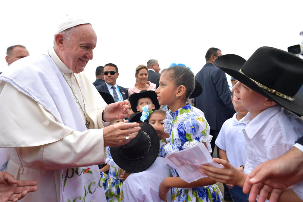 Pope Francis is welcomed by a group of children upon his arrival in Villavicencio, Colombia, on Friday.