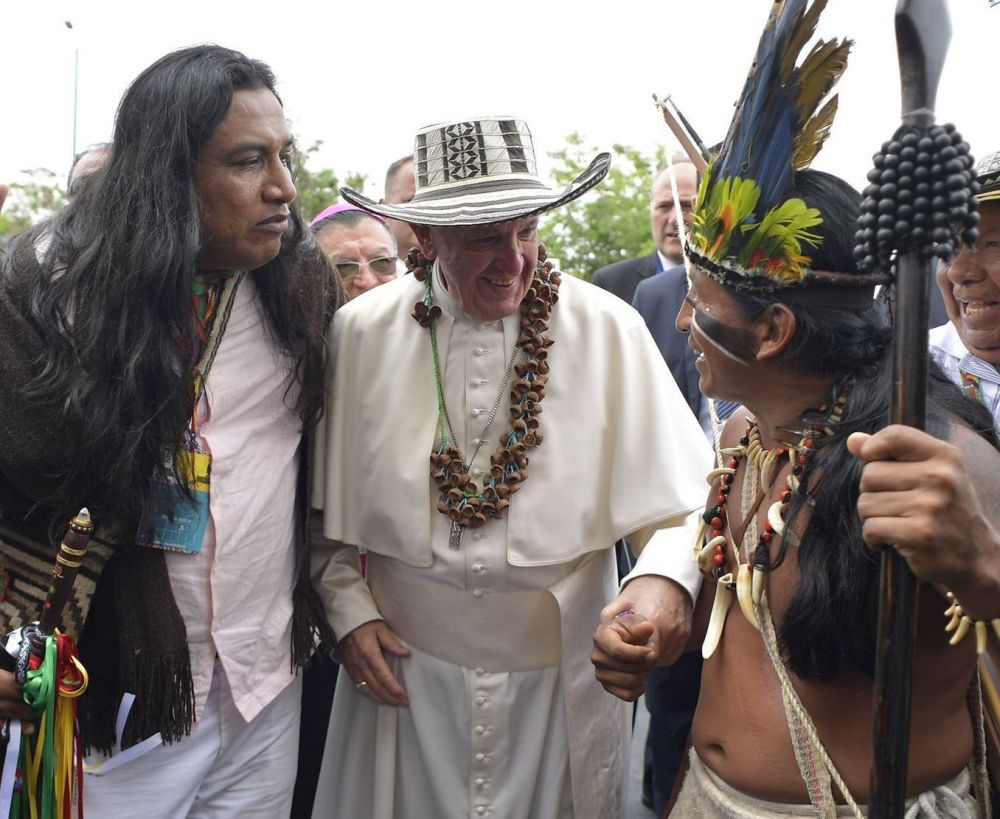 Representatives of Colombia's indigenous community pose with Francis in Villavicencio, Colombia, on Friday. Political violence left over 250,000 people dead and millions displaced.