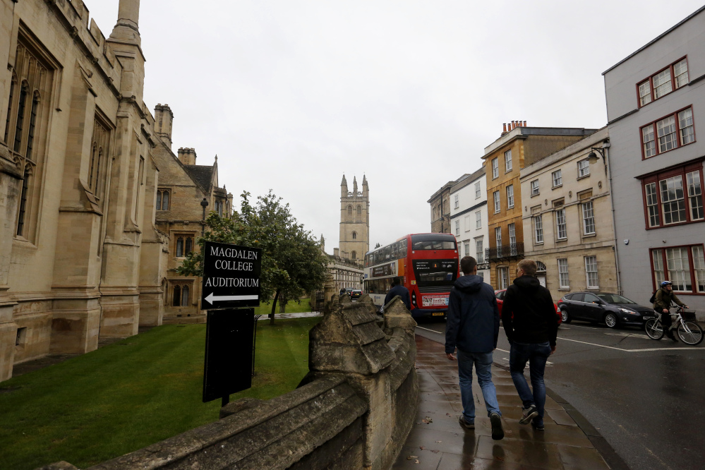 Young people walk around Oxford University's campus inEngland. The number of EU applicants to British universities fell this year for the first time since 2012, as EU nationals remain uncertain of their rights in post-Brexit Britain.