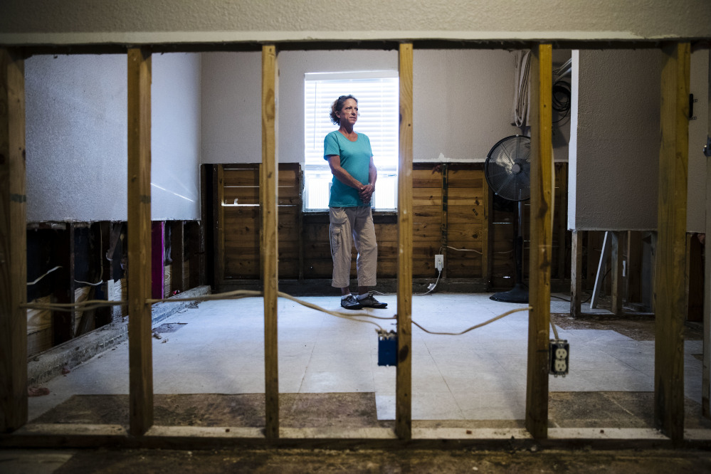 Julie Boon, director of Eudaimonia Recovery Homes poses for a photograph at her facility in Houston which was damaged by Hurricane Harvey. In the aftermath of flooded Houston, Boon oversaw repairs at a sober-living home while giving advice to residents based on her own 30 years of sobriety.