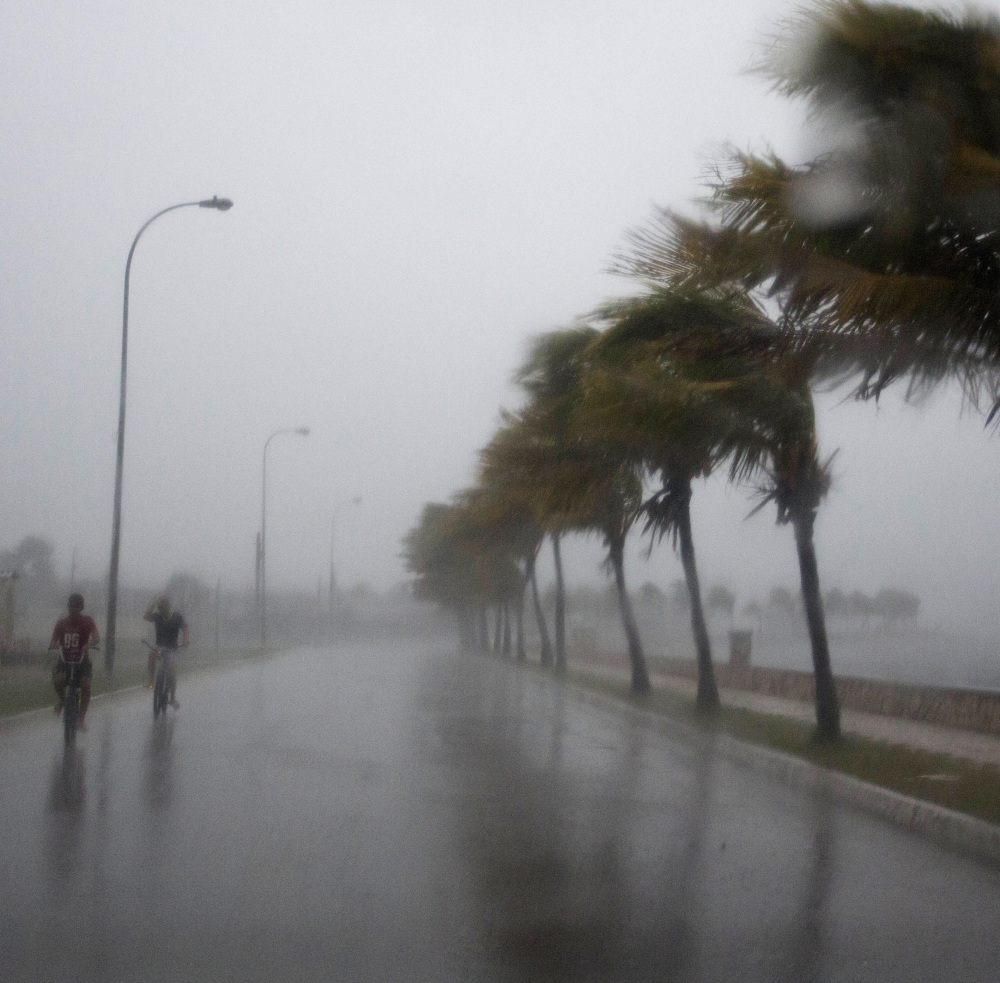 Caibarien, Cuba, gets a dose of Irma's winds on Friday, while Havana, left, is battered by the storm surge on Saturday.