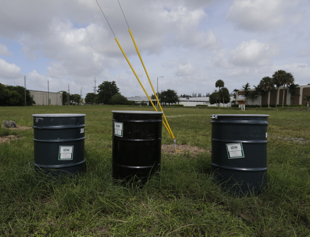 Barrels containing chemical waste sit in a field designated by the EPA as a polluted Superfund site called Anodyne North Miami Beach.