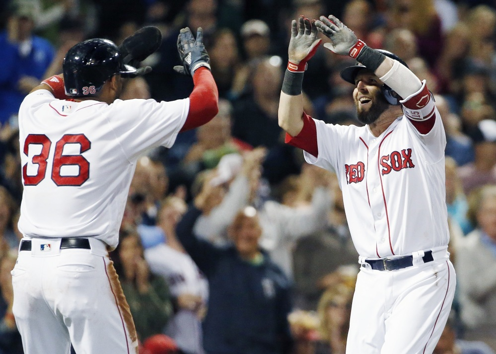 Boston's Dustin Pedroia, right, celebrates his two-run home run that also scored Eduardo Nunez, left, during the first inning against Tampa Bay on Saturday night. The Red Sox won, 9-0.