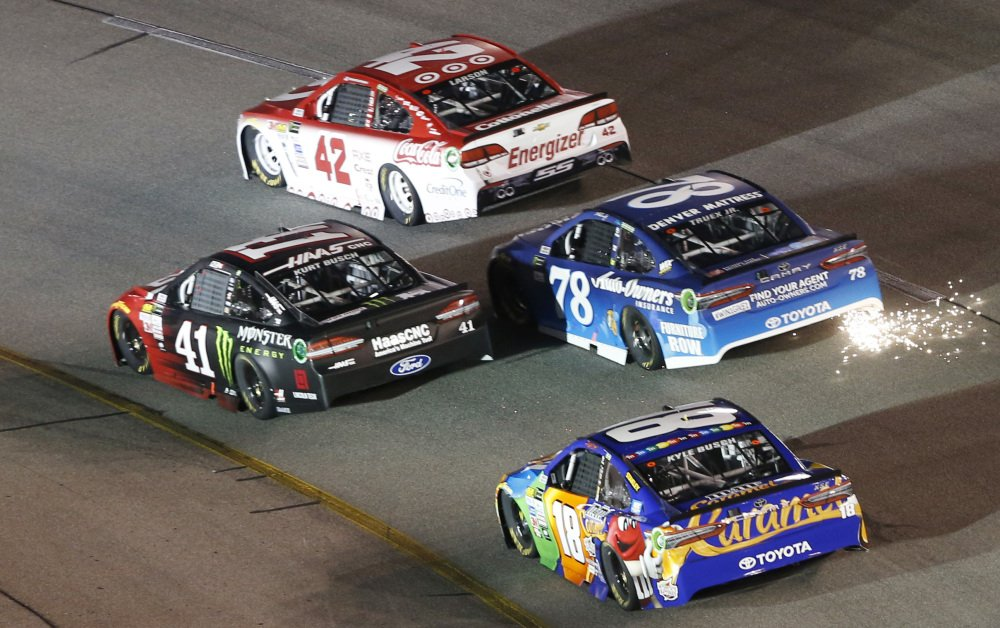 Martin Truex Jr.'s car trails sparks in Turn 2 of the Richmond International Raceway in Richmond, Va., Saturday night, but what really set him off was having a potential victory snatched from him because of a late caution that might not have been warranted.