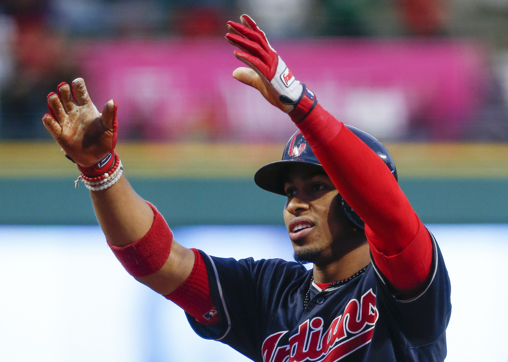 Cleveland's Francisco Lindor celebrates after leading off the bottom of the first with his 30th home run to help the Indians win their 20th straight game, 2-0, on Tuesday in Cleveland.