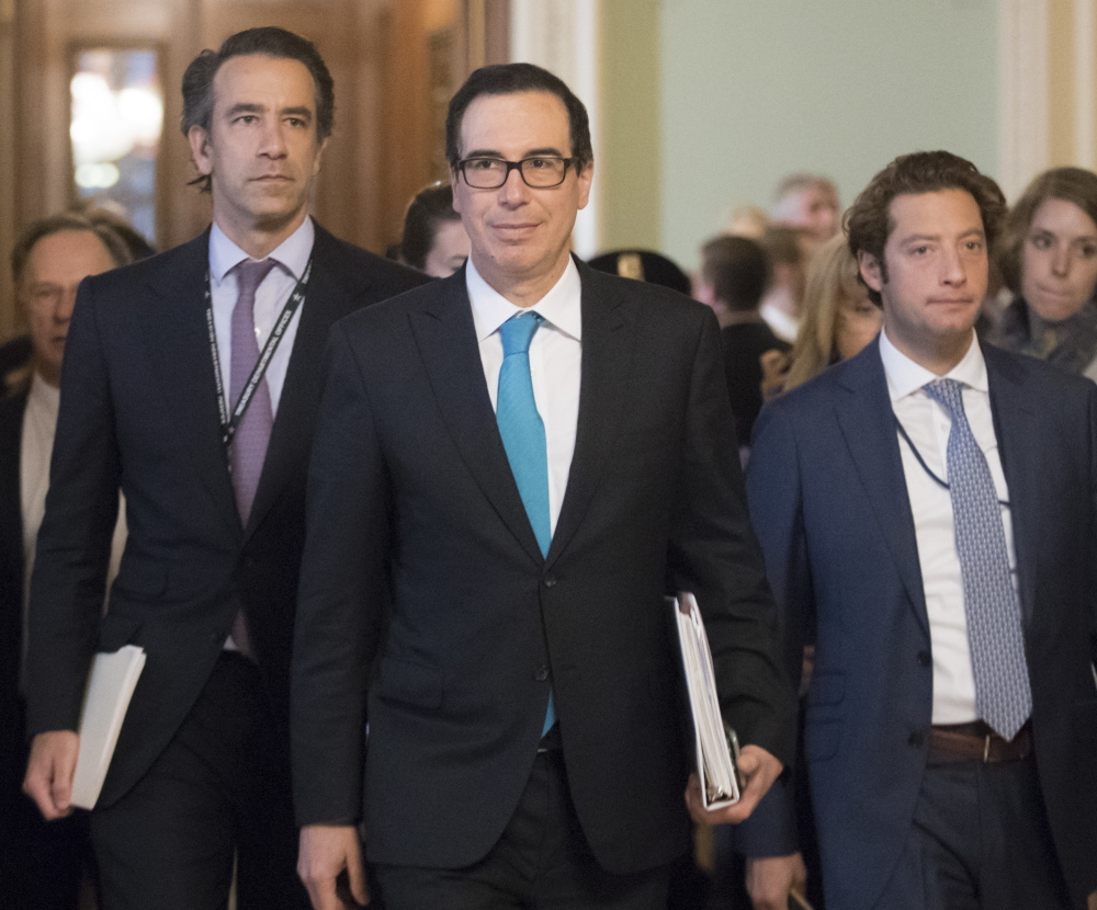 Treasury Secretary Steven Mnuchin arrives at the Capitol on Tuesday for a closed-door meeting with Senate Majority Leader Mitch McConnell, R-Ky., on the tax code overhaul.
