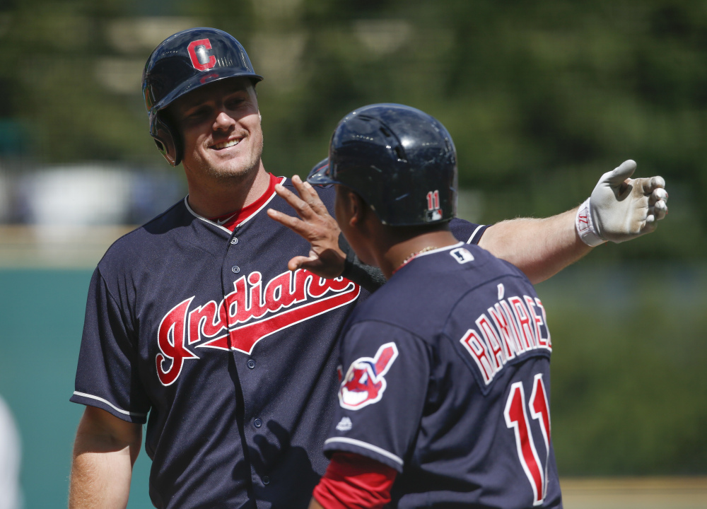 Cleveland Indians outfielder Jay Bruce celebrates with Jose Ramirez (11) after hitting a three-run home run off Detroit starting pitcher Buck Farmer during the first inning Wednesday in Cleveland.