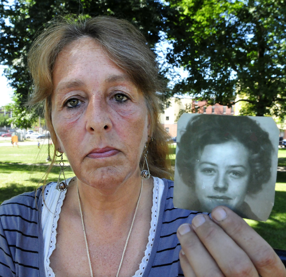 Honey Rourke of Lewiston holds a 1970 photograph of her mother, Pauline Rourke, on July 26. Pauline Rourke disappeared in 1976 and is believed to have been murdered by Albert Cochran, who died recently in prison.