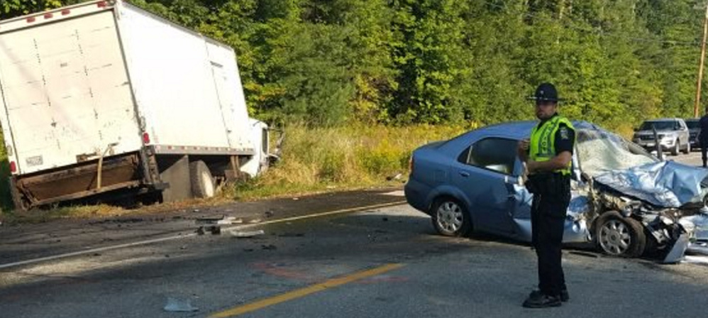 Police investigate Tuesday morning after a box truck swerved to avoid a pedestrian on Route 201 in Skowhegan but hit him and a car traveling in the other direction.