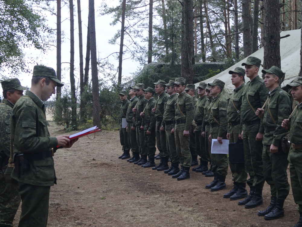 Belarus' Col. Alexander Prokopenko, left, reads an order to start drills at a training ground at an undisclosed location in Belarus on Thursday as war games with Russia begin.