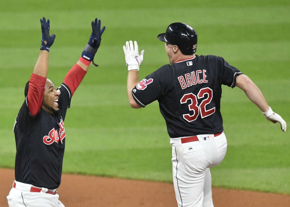 Jay Bruce of the Indians, right, is congratulated by teammate Edwin Encarnacion after hitting the winning RBI single in the 10th inning against the Royals on Thursday in Cleveland.