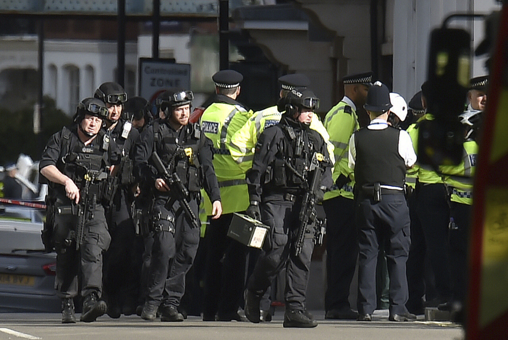 Armed police respond at Parsons Green station in west London after an explosion on a packed London Underground train on Friday.