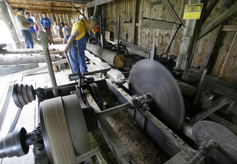 David Newhall operates the saw at the Robinson Sawmill in Calais, Vt.