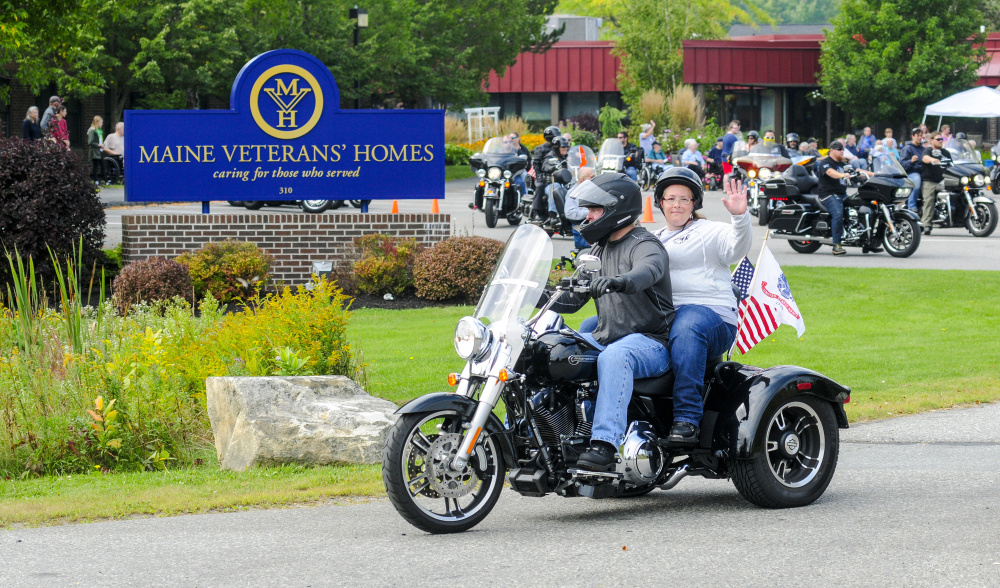 Dozens of bikers in the 2017 Maine Fallen Heroes Bike Run head for Lewiston on Saturday from the Maine Veterans' Home in Augusta.