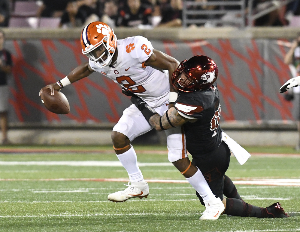 Clemson's Kelly Bryant is tackled by Louisville's James Hearns on Saturday night in Louisville, Ky. Clemson won 47-21.
