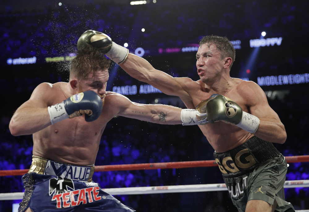 Gennady Golovkin, right, connects with a right to Canelo Alvarez during their middleweight title fight Sunday night in Las Vegas. The pair fought to a 12-round draw.