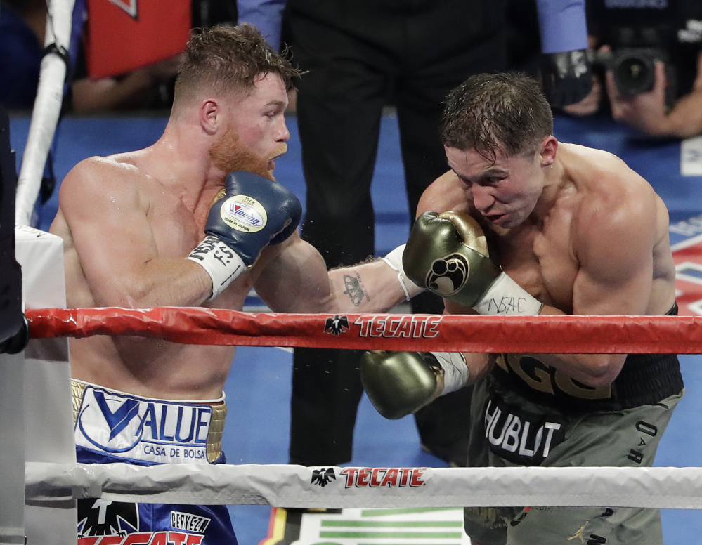Canelo Alvarez, left, fights Gennady Golovkin during a middleweight boxing bout Saturday night in Las Vegas. The pair are expected to schedulde a rematch soon.