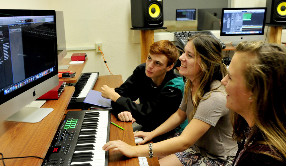 Maine Central Institute students confer on a music project in the Digital Music Production lab inside the new Visual & Performing Arts Education Center at the Pittsfield school. From left are T.J. Stewart, Allison Hughes and Sarah Welch.