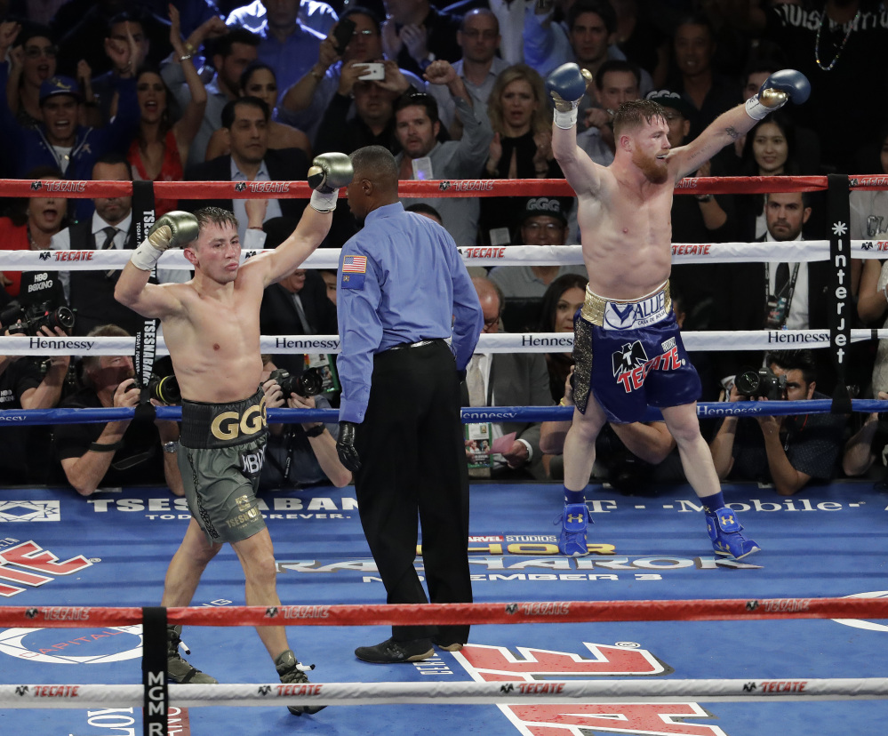 Canelo Alvarez, right, and Gennady Golovkin celebrate after their middleweight title fight Saturday in Las Vegas. The fight was called a draw.
