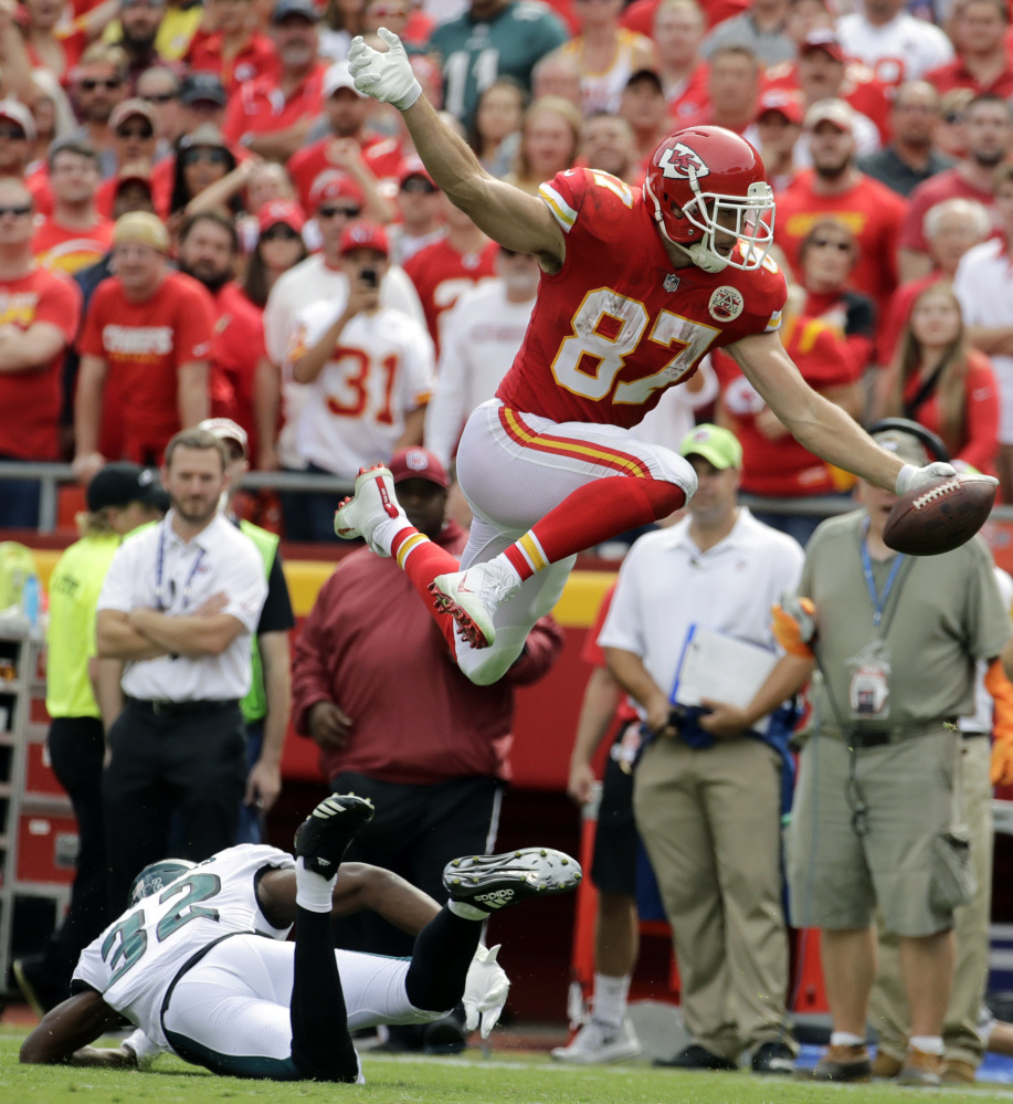 Chiefs tight end Travis Kelce leaps over Eagles cornerback Rasul Douglas to score a touchdown on a 15-yard reception during Kansas City's 27-20 win Sunday. Kelce caught eight passes for 103 yards as he helped the Chiefs improve to 2-0.