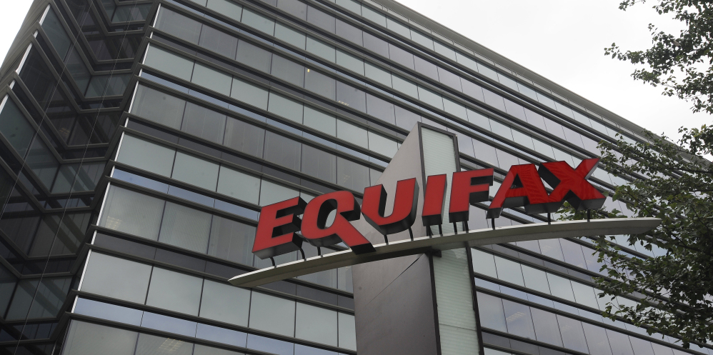 Photo shows Equifax Inc. offices in Atlanta. A Justice Department investigation will focus on whether top officials at Equifax violated insider trading laws when they sold stock before the company disclosed it had been hacked.