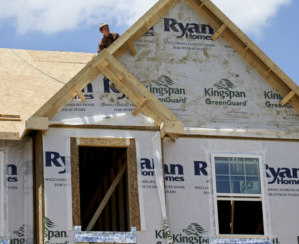 Builders work on the roof of a home in Jackson Township, Pa. On Monday, the National Association of Home Builders/Wells Fargo released its September index of builder sentiment.