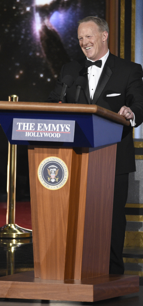 Former press secretary Sean Spicer speaks at the 69th Primetime Emmy Awards on Sunday at the Microsoft Theater in Los Angeles.