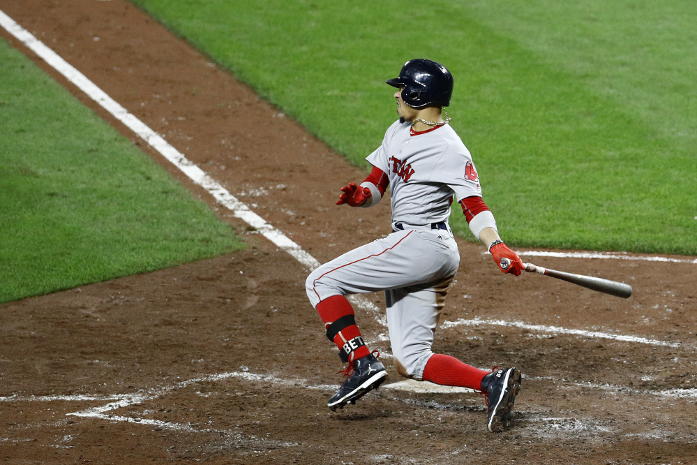Mookie Betts hits a three-run double in the fifth inning, in which the Red Sox scored six runs to take a 7-6 lead. Xander Bogaerts, Brock Holt and Andrew Benintendi scored on the play.