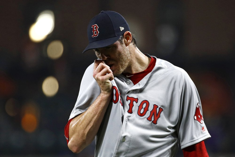 Red Sox starter Doug Fister wipes his face as he walks off the field after giving up three runs in the second inning. Fister's outing ended in the third inning, after he gave up five earned runs and walked five batters.