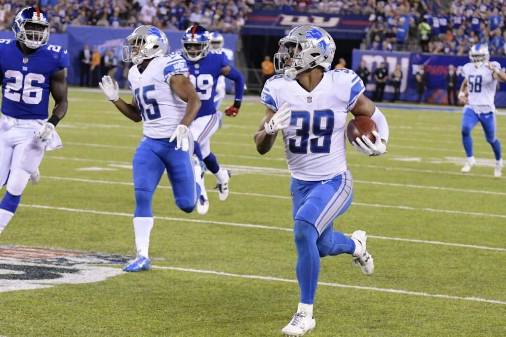 Jamal Agnew returns a punt for a touchdown for the Lions in the second half of their road win over the New York Giants.