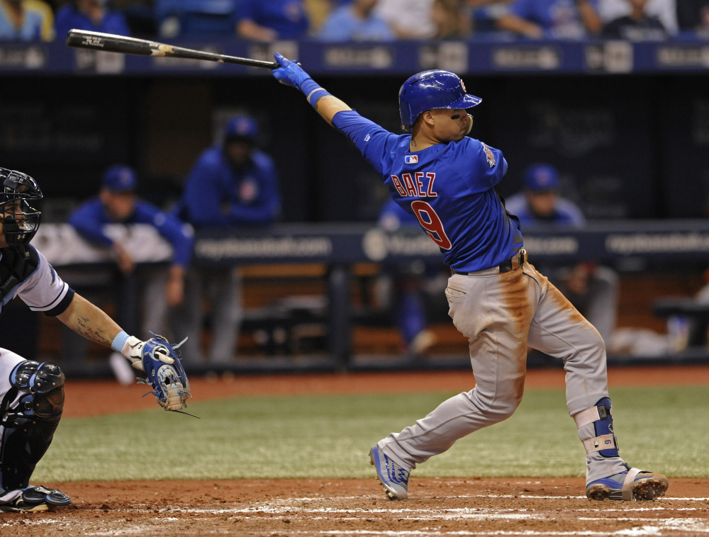 Javier Baez of the Cubs hits an RBI double against the Rays in the fourth inning Tuesday night in St. Petersburg, Fla.
