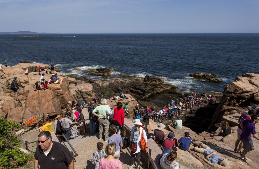 Tourists flock to Thunder Hole at Acadia National Park in June 2016.