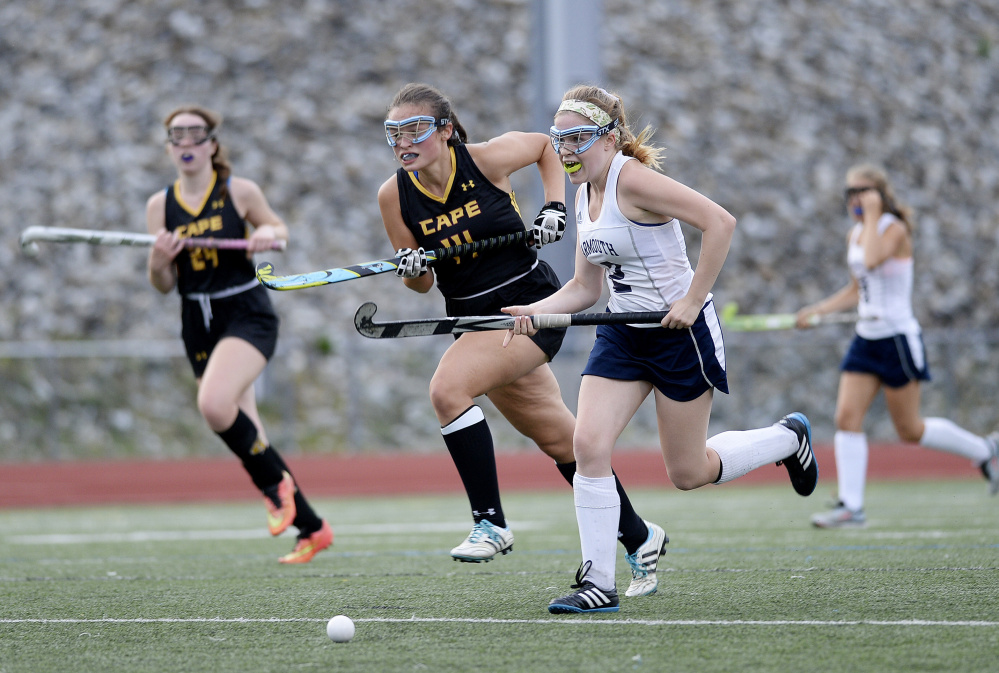 Isabelle King of Yarmouth chases the ball down the field ahead of Katie Beth Dunham of Cape Elizabeth during Yarmouth's 4-1 victory Wednesday in a Western Maine Conference field hockey game at Yarmouth High.