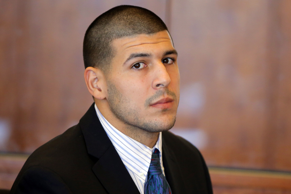 An autopsy revealed that the brain of former New England Patriots player Aaron Hernandez, shown in 2013, showed severe signs of the degenerative brain disease chronic traumatic encephalopathy, which can be caused by repeated brain trauma and can lead to behavior changes, his lawyer said Thursday.
